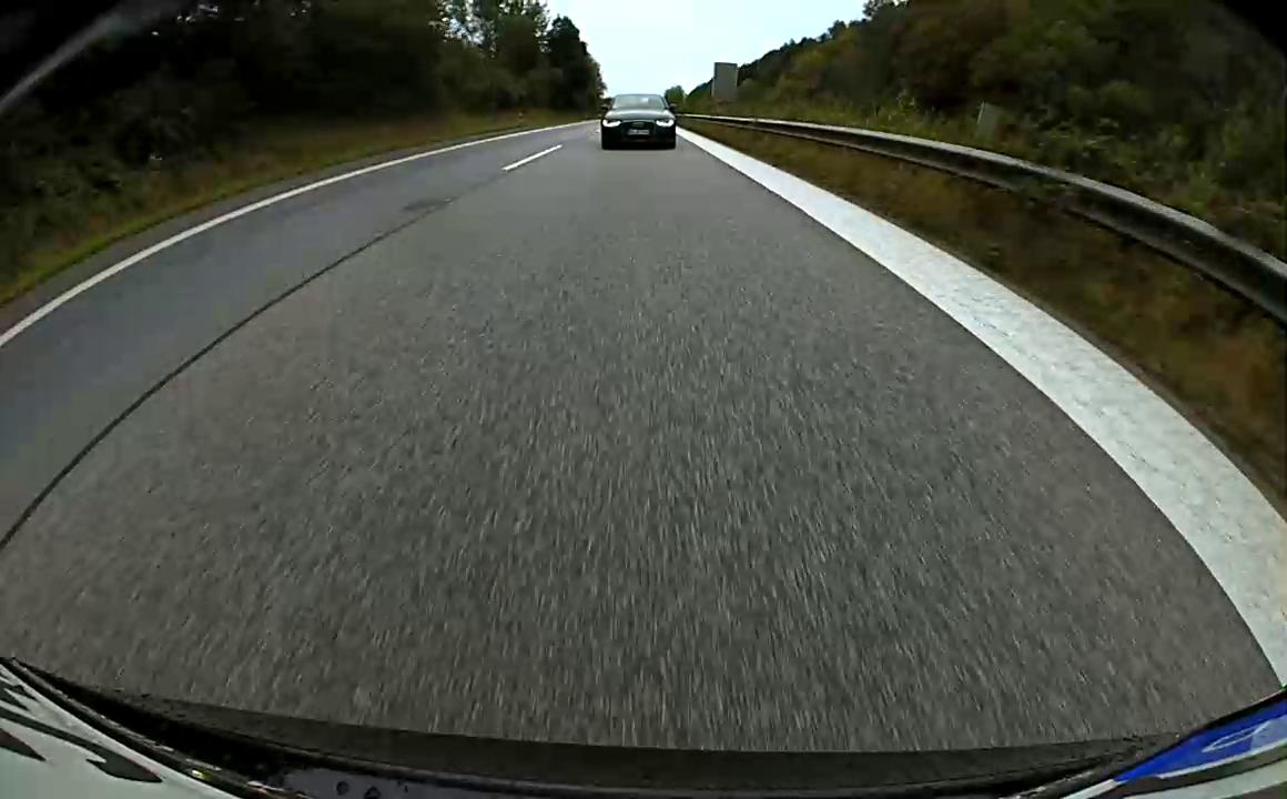 Audi A6 tailing a Tesla Model S at 200 km/h (124 mph)