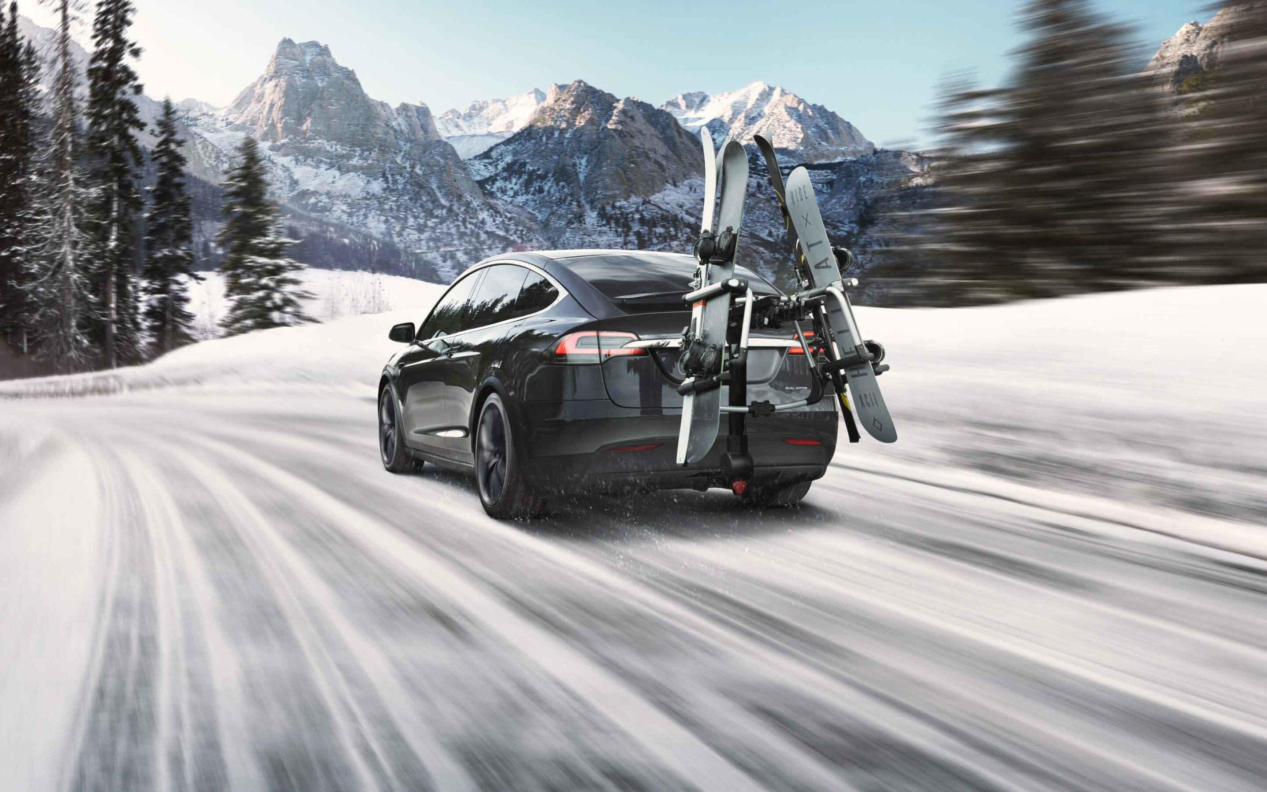Tesla Model X on snow with ski gear