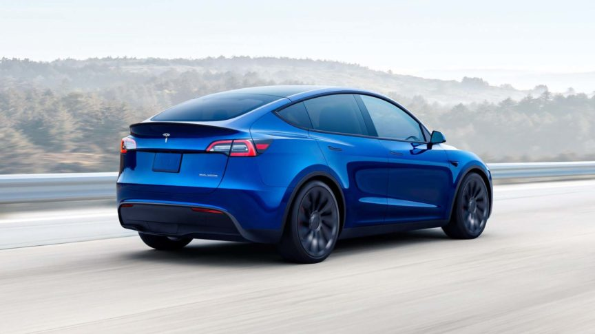 Blue Tesla Model Y on highway