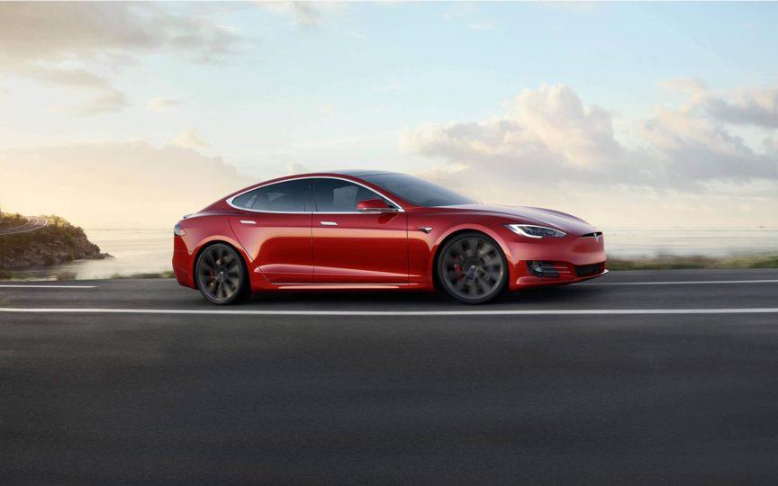 Tesla Model S Performance on the road near the sea side
